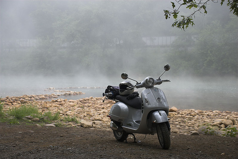 Vespa GTS scooter on a foggy morning along the west branch of the Susquehanna River