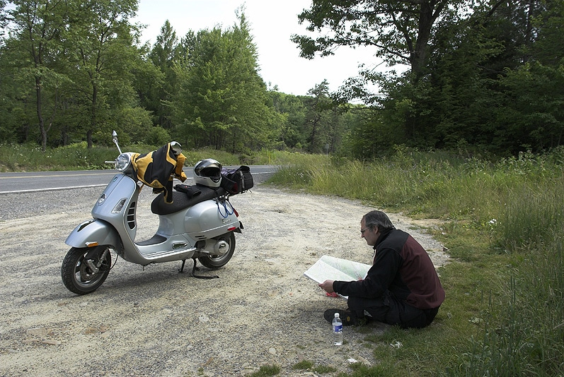 Steve Williams and Vespa scooter looking at map in Quehanna Wilderness Area