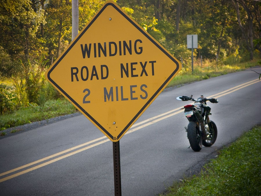 Ducati Hypermotard motorcycle on a winding road