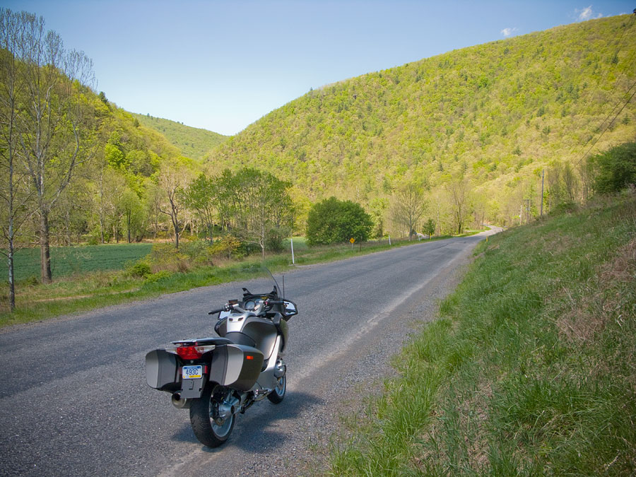 BMW R1200 RT motorcycle along the road in a narrow Pennsylvania valley