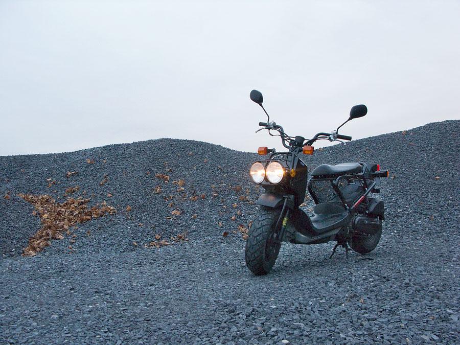 Honda 50cc Ruckus scooter along a rural road