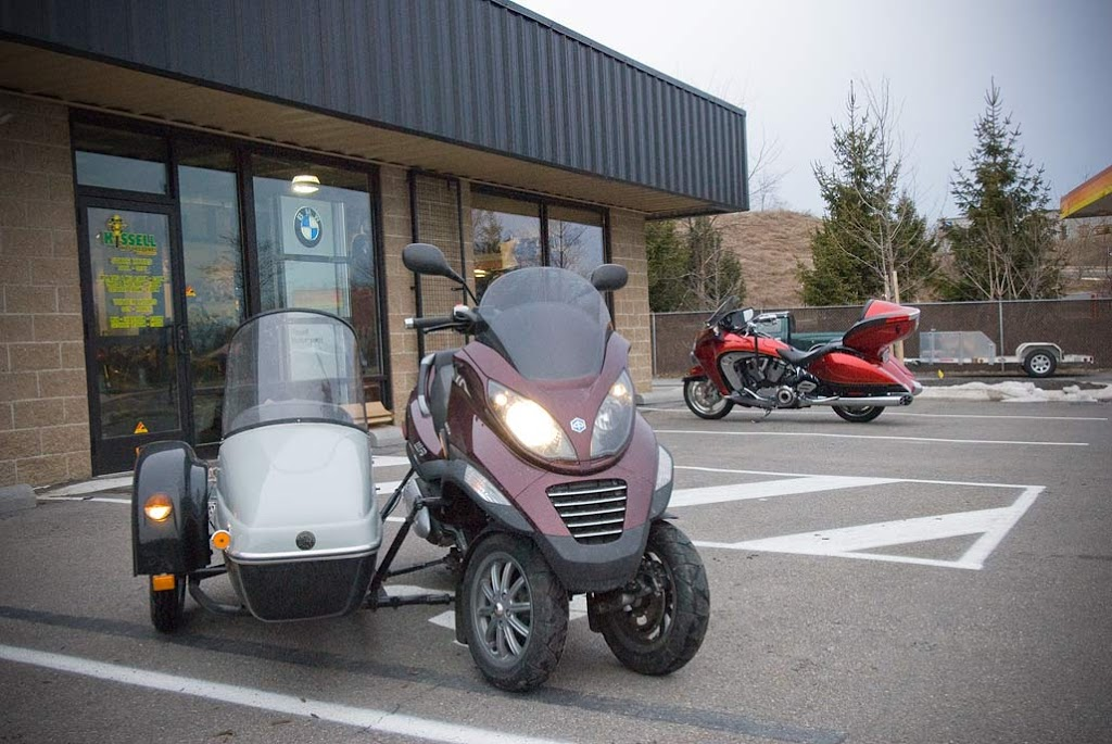 a piaggio mp3 with a sidecar - scooter in the sticks