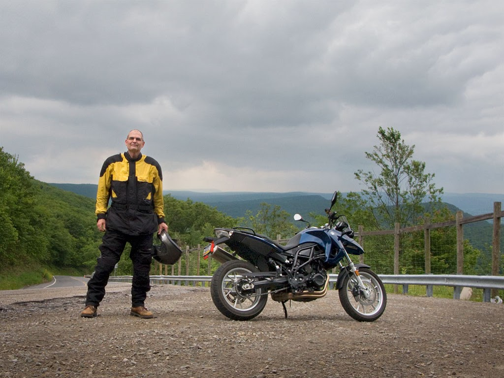Steve Williams with BMW F650 motorcycle