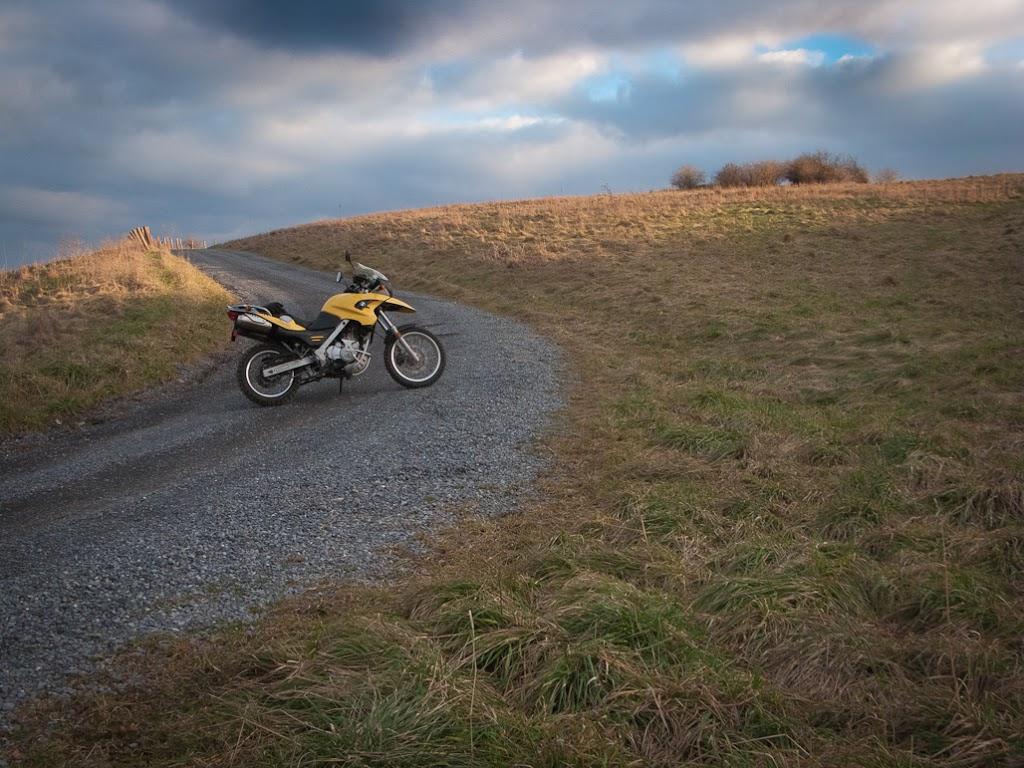BMW 650 GS motorcycle on gravel lane