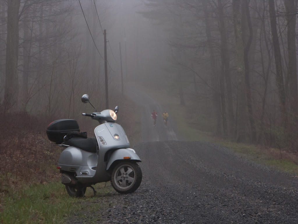 Vespa GTS scooter in fog