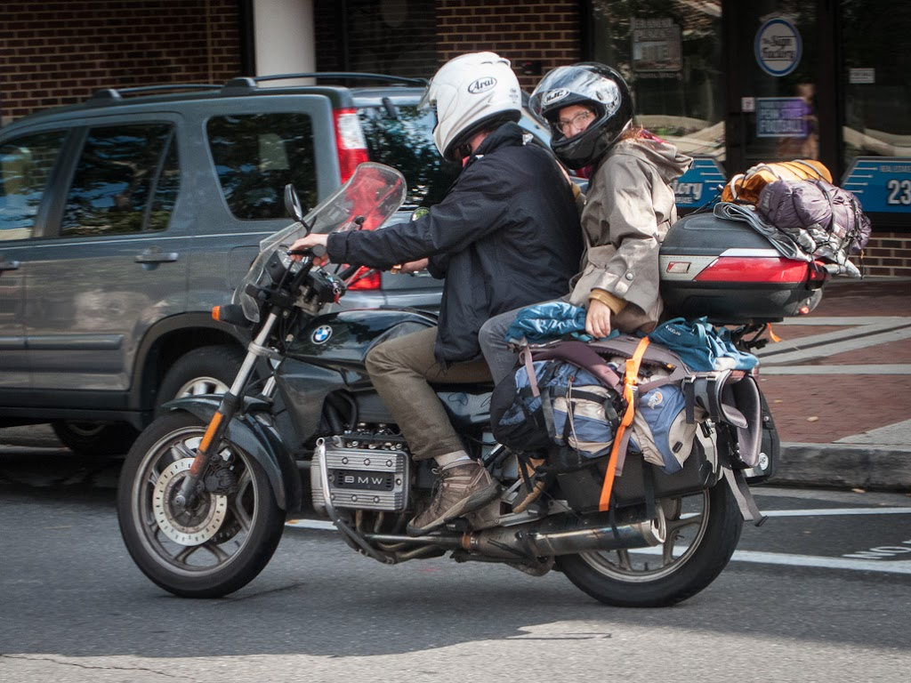 Young couple riding on a BMW K75 motorcycle