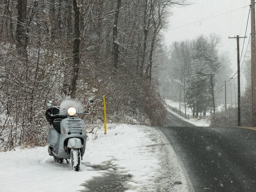 Vespa scooter along road in winter