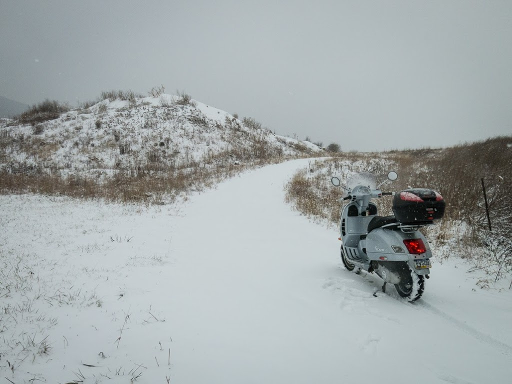 Vespa GTS scooter going off road in snow