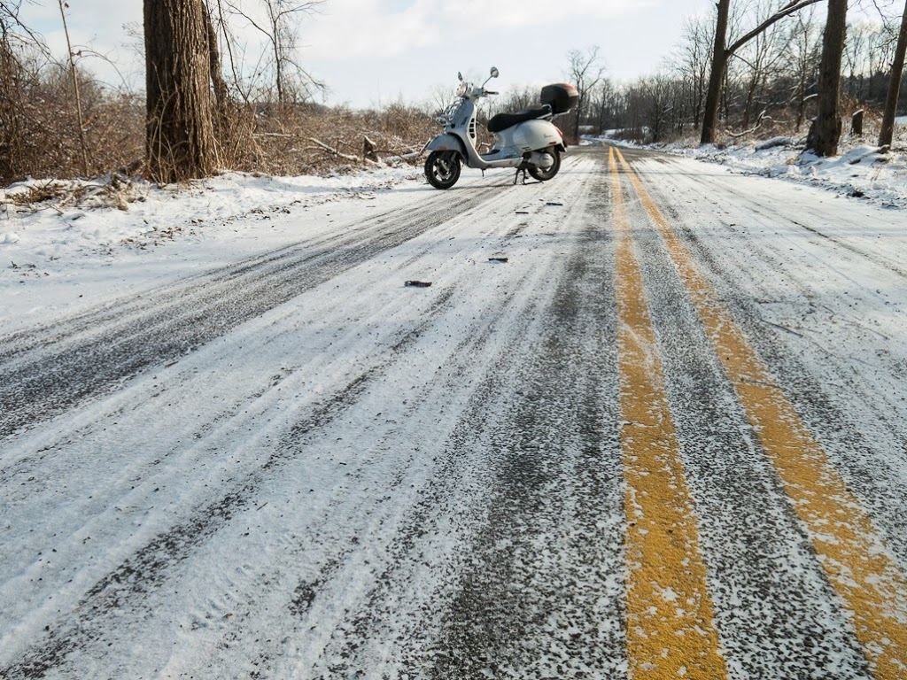 Vespa GTS scooter on snow covered road