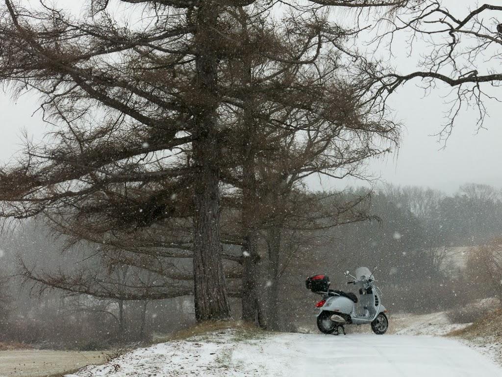 Vespa GTS scooter on a snowy winter ride