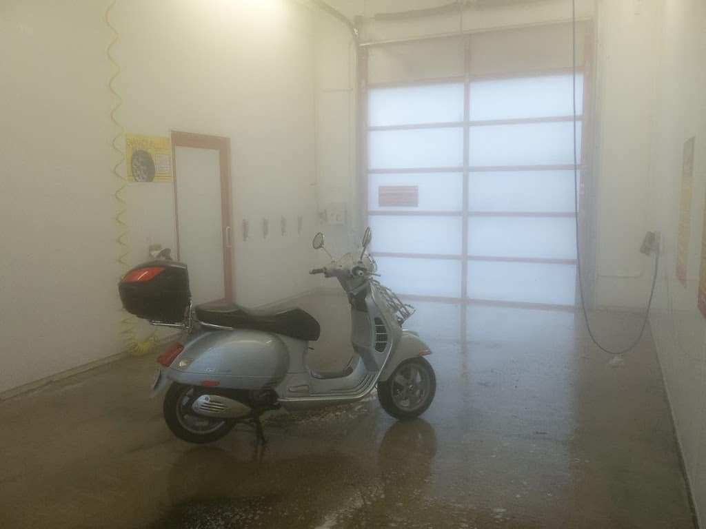 Vespa GTS scooter is self wash bay
