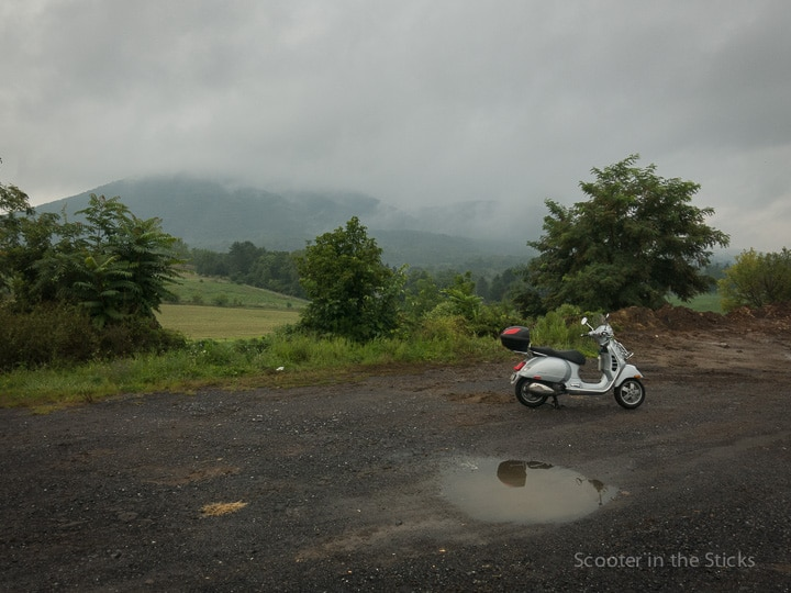 Rain riding a Vespa GTS scooter and Mt. Nittany