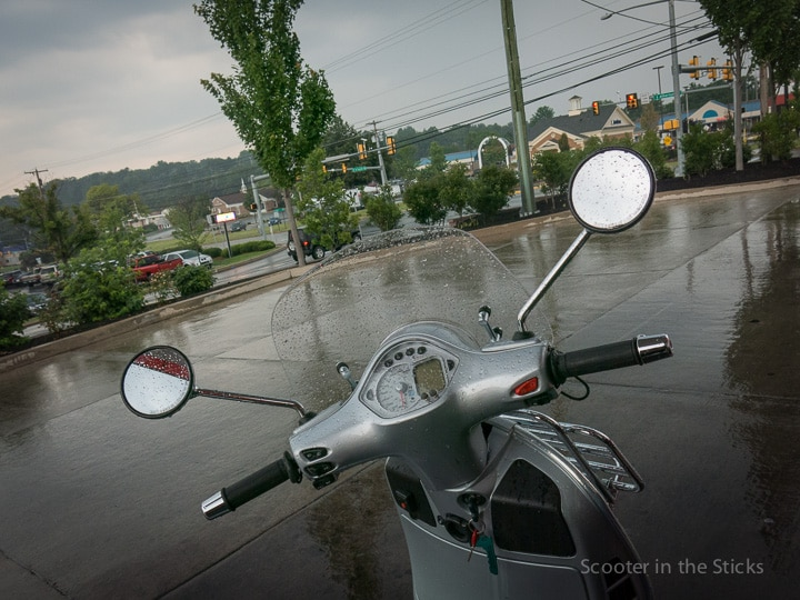 Vespa GTS scooter in the rain