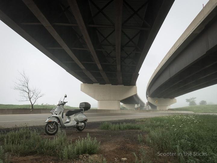 Vespa GTS scooter along foggy highway