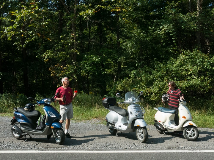 three scooters along the road