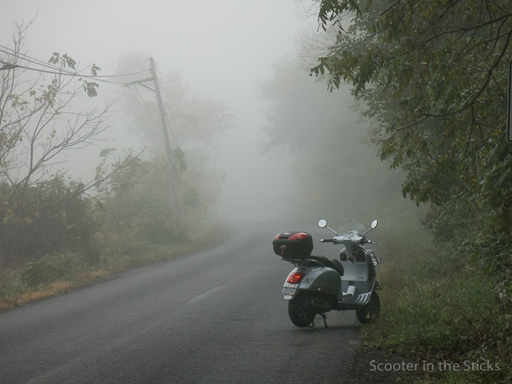 Vespa GTS scooter on a rural road
