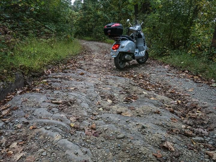 Vespa GTS scooter on a rocky road