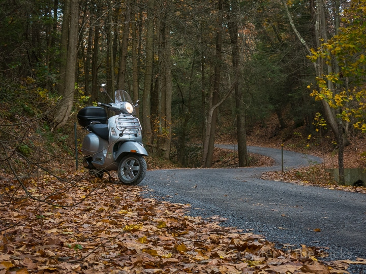 Vespa GTS scooter on gravel road