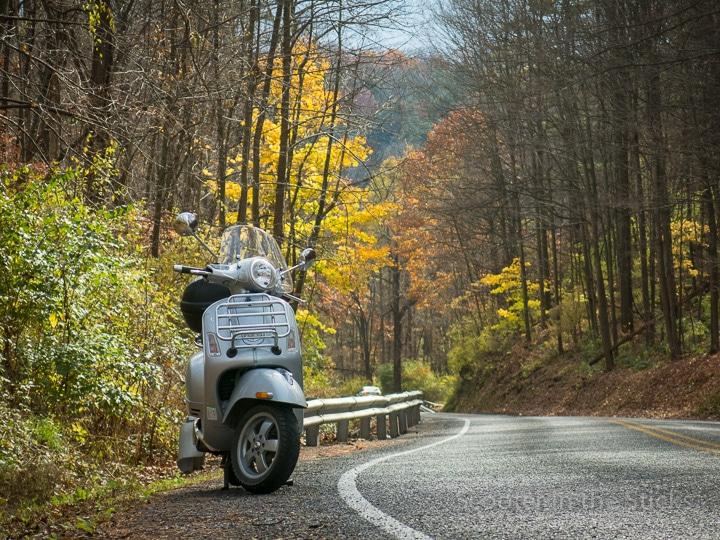 Vespa GTS scooter on winding country road