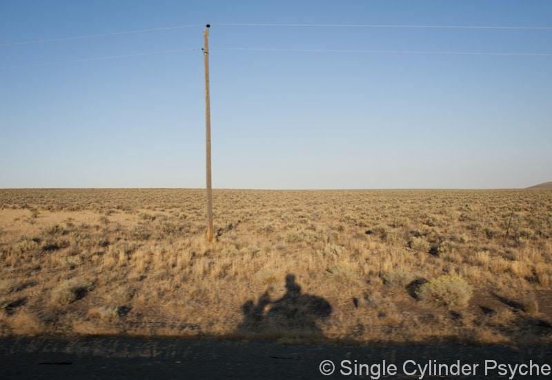 shadow of a Vespa rider
