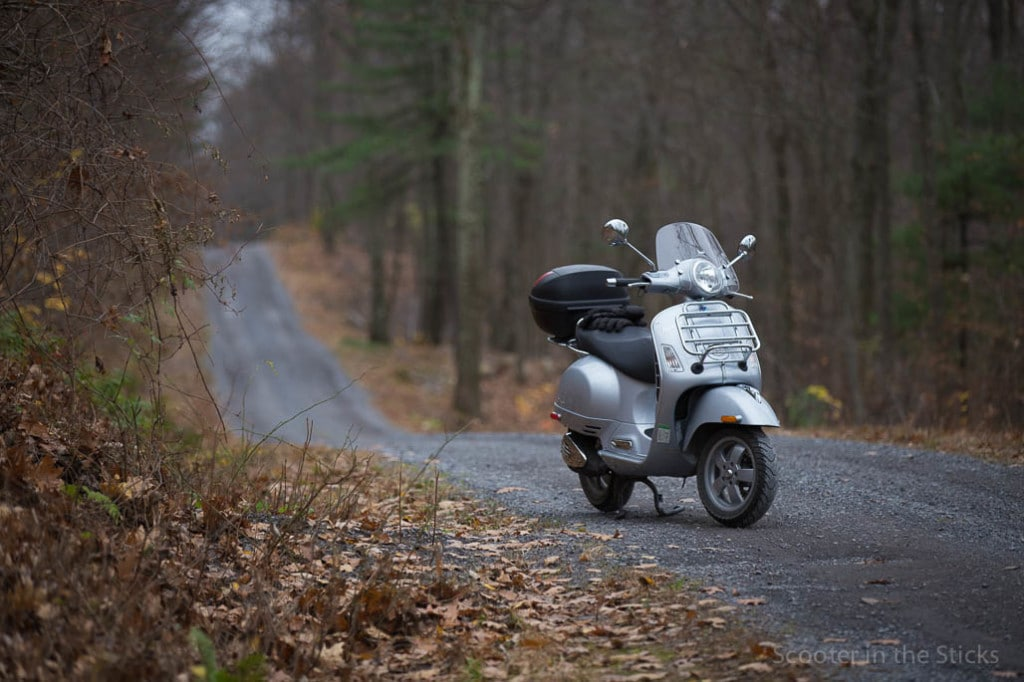 Vespa GTS 250ie scooter on gravel road