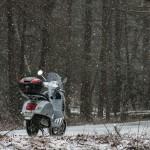 Vespa Riding in Snow