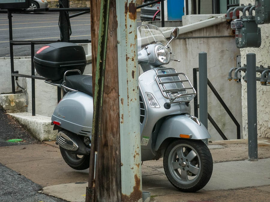 Vespa scooter illegally parked