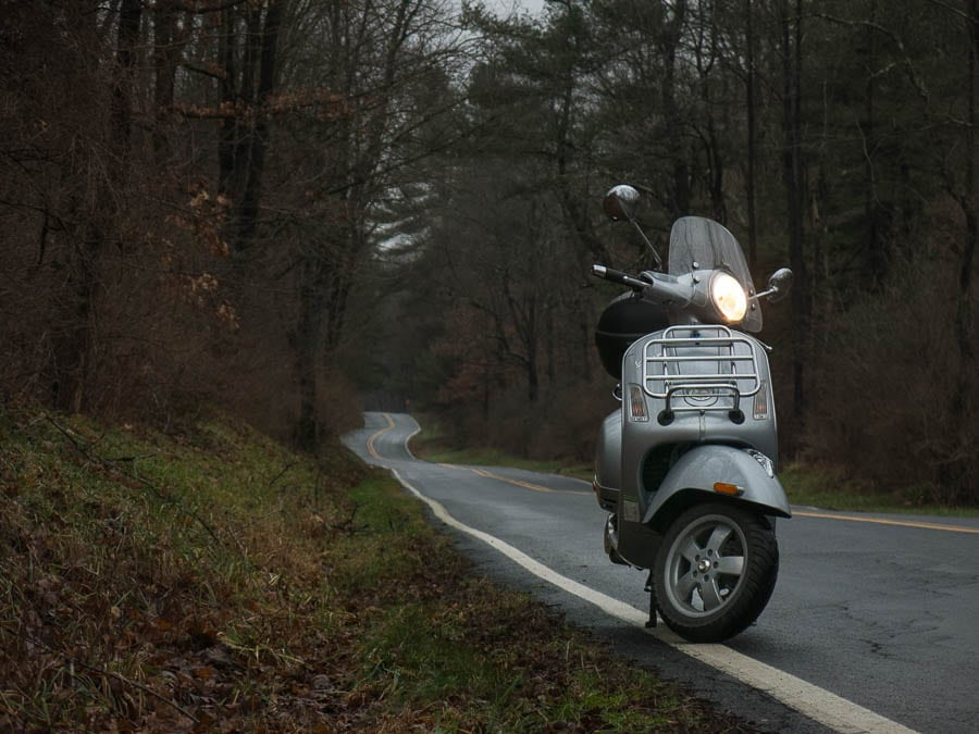 Vespa GTS scooter on winding wet road