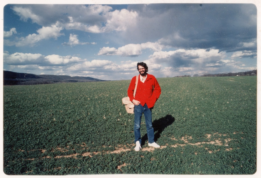 Steve Williams, photographer, standing in a field outside of Boalsburg, Pennsylvania in the 1980s.