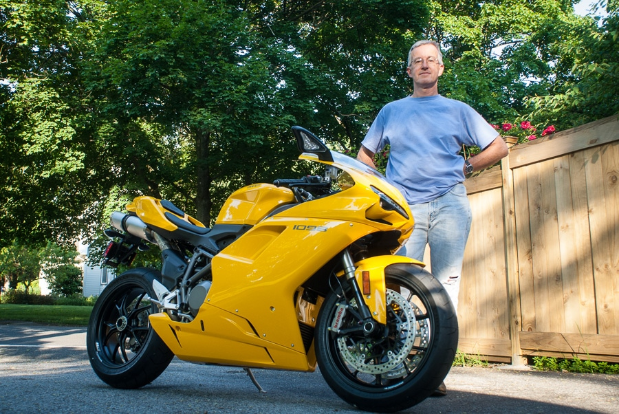 Paul Ruby with a yellow Ducati motorcycle