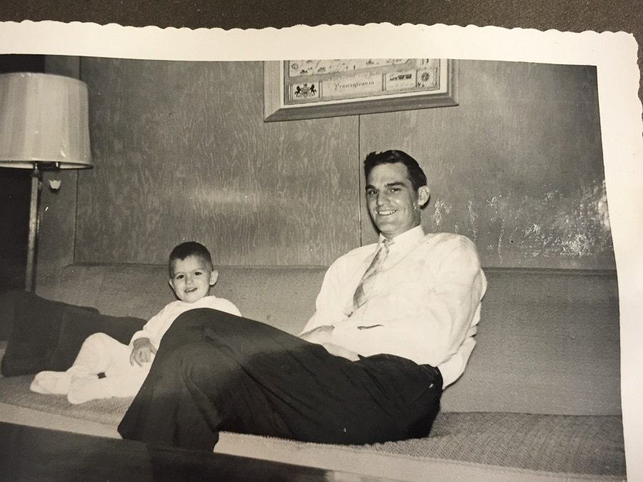 father and son on living room couch