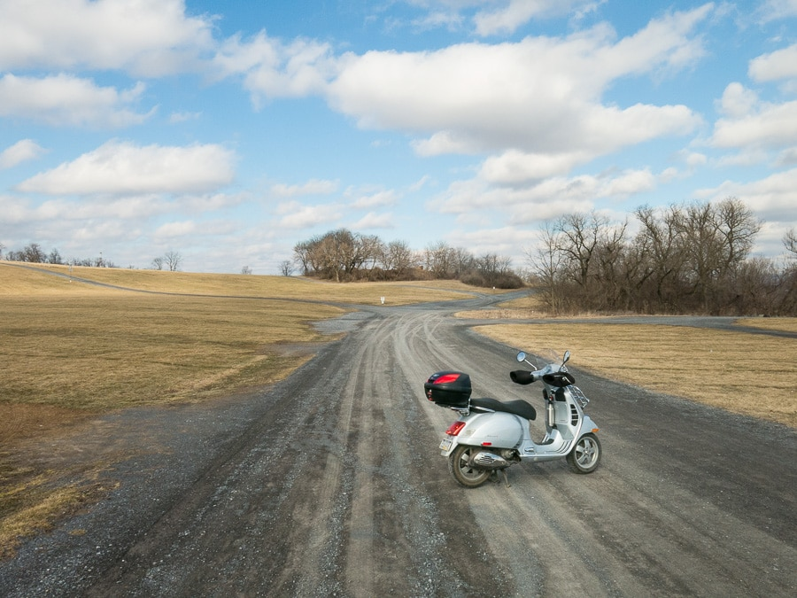 Vespa on gravel road