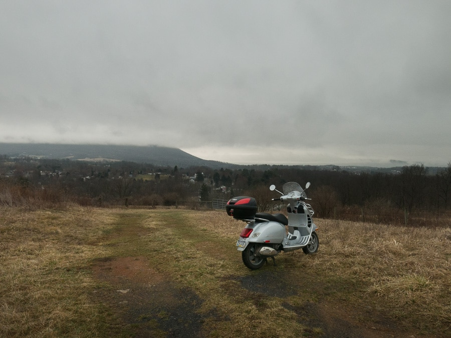 Vespa GTS scooter and rain in dawn light