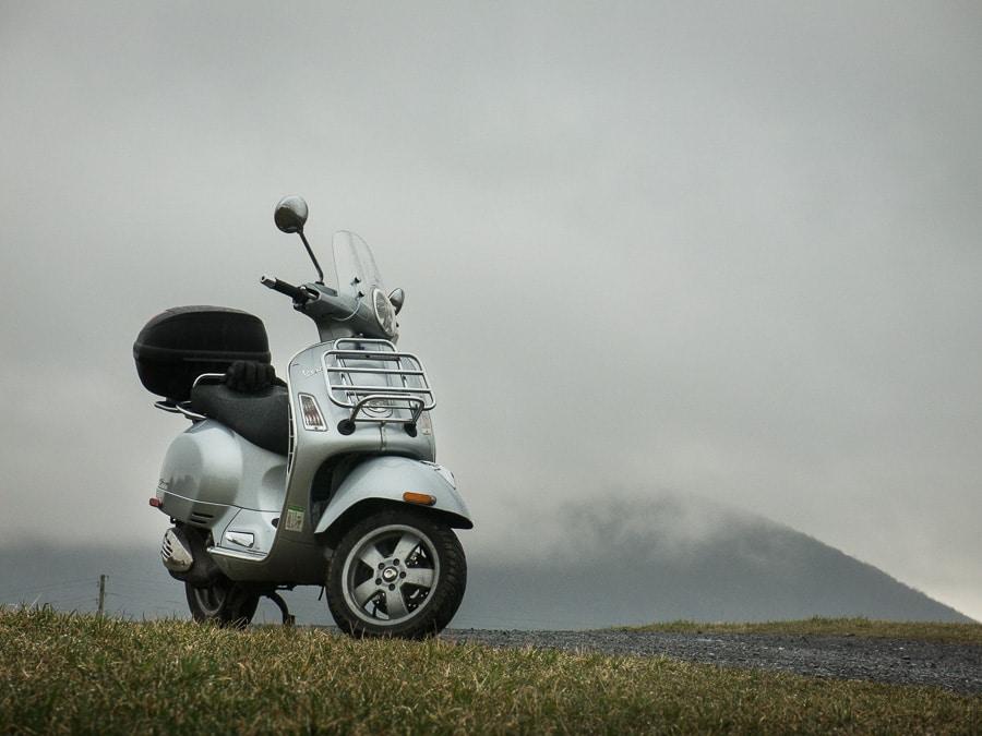 Vespa GTS scooter on rainy day