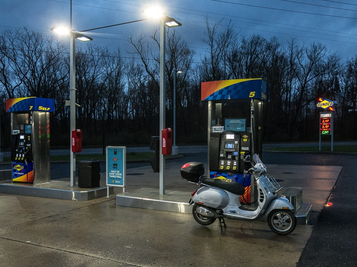 Vespa GTS scooter at a Sunoco station