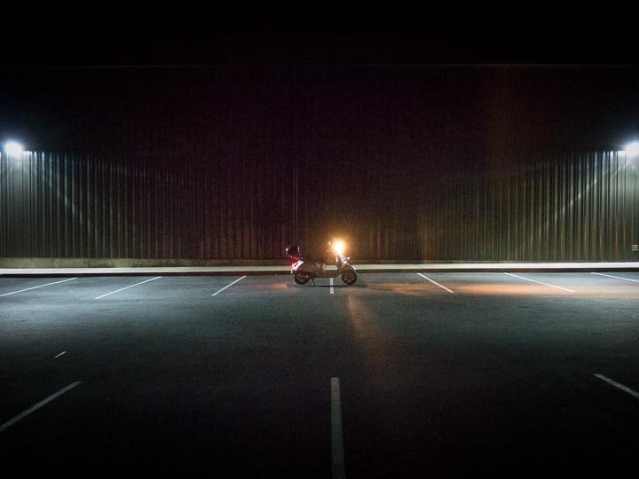Vespa GTS scooter at night