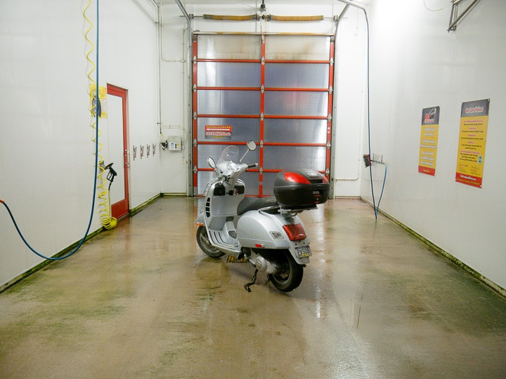 Vespa GTS scooter in wash bay