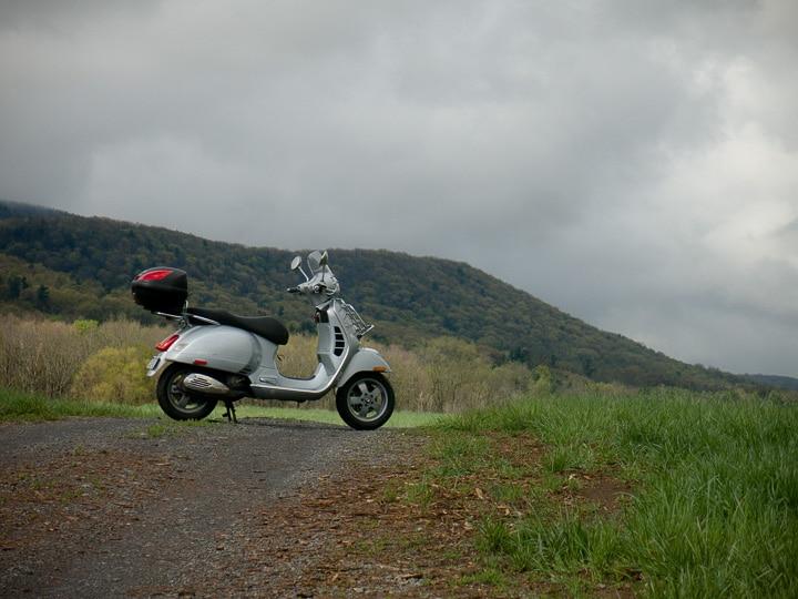 Vespa GTS250 scooter on a farm lane
