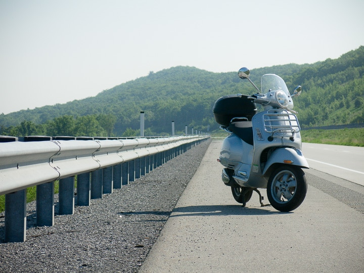 Vespa GTS scooter along the freeway