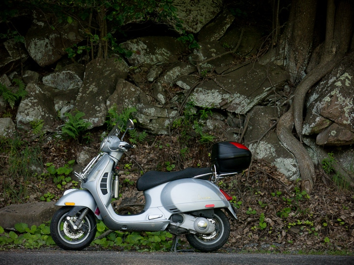Vespa GTS scooter along mountain road