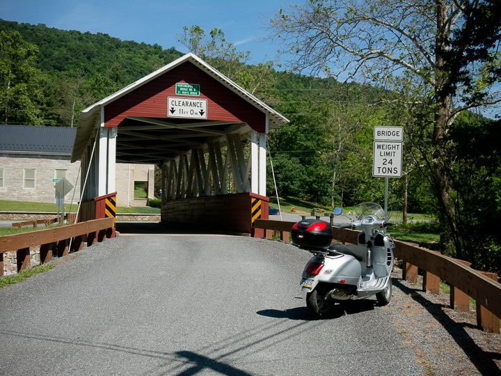 Vespa GTS scooter and covered bridge