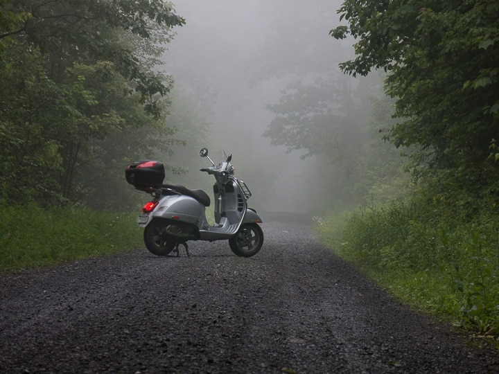 Vespa GTS scooter on foggy gravel road