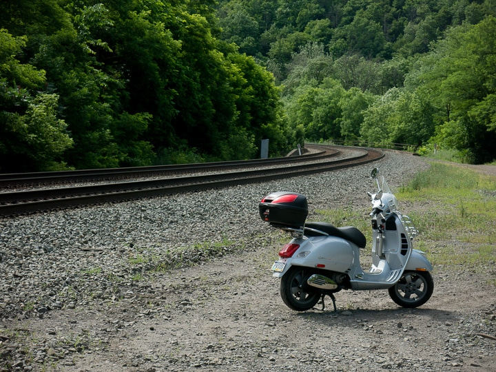 Vespa GTS scooter along the railroad tracks