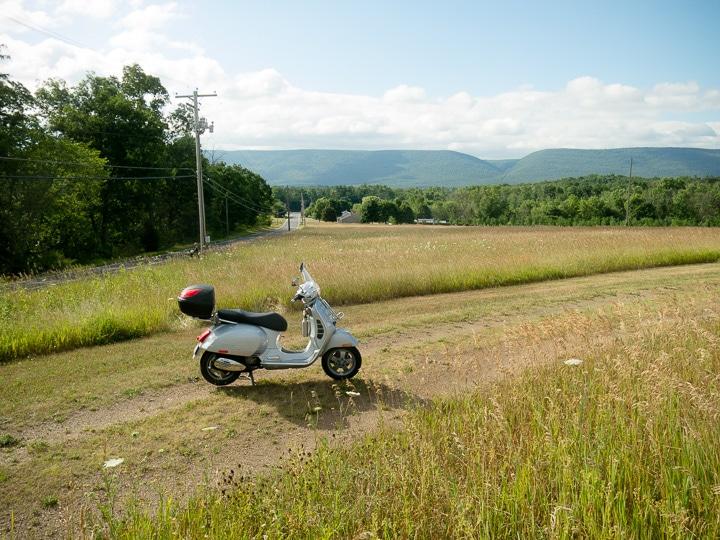 Vespa GTS scooter in a farm field