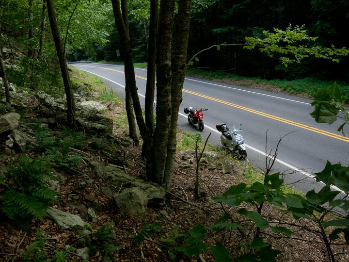 Vespa scooter and Ducati Hypermotard motorcycle in the mountains of Pennsylvania