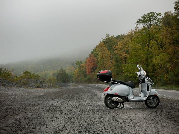 Vespa GTS scooter on a foggy, fall morning