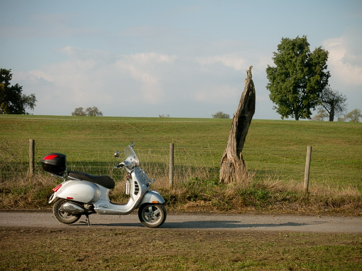 Vespa GTS scooter in fall light
