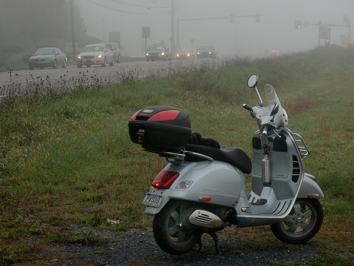 Vespa GTS scooter and traffic in fog