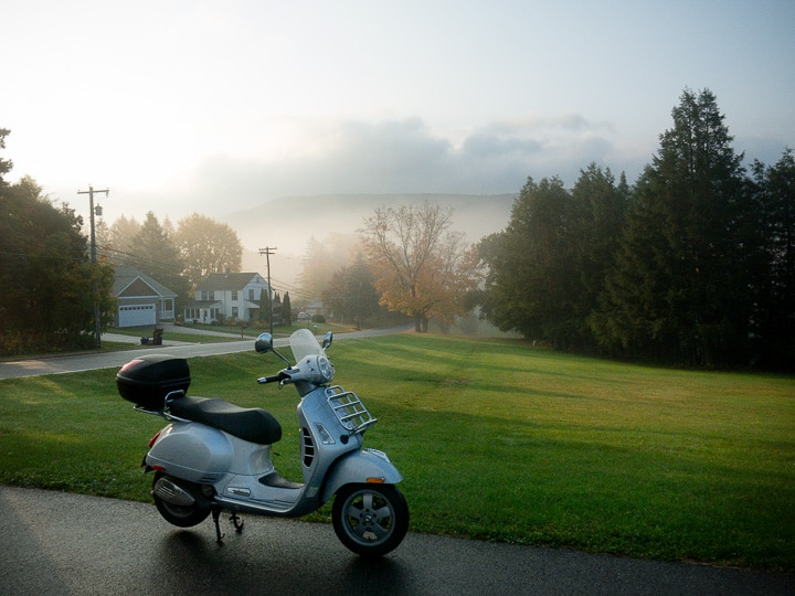 Vespa GTS scooter on a foggy morning