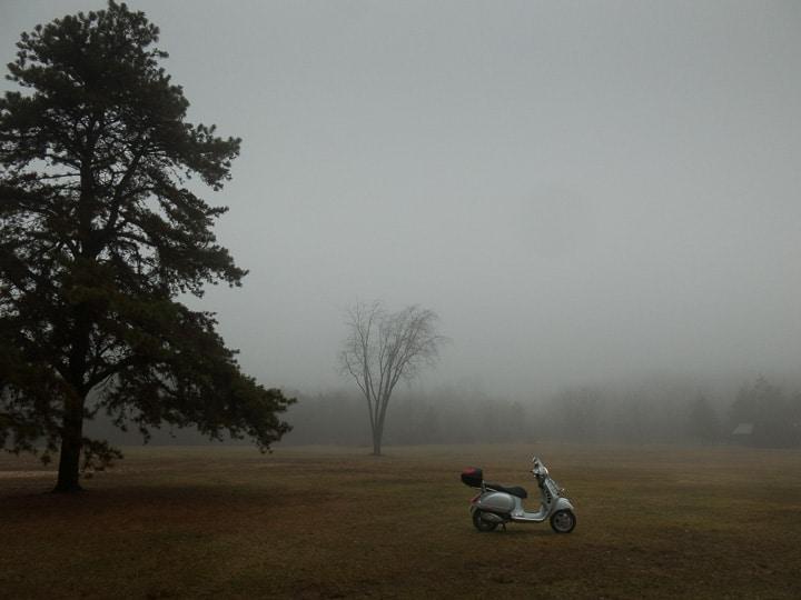 Slow travel on a Vespa on a foggy morning